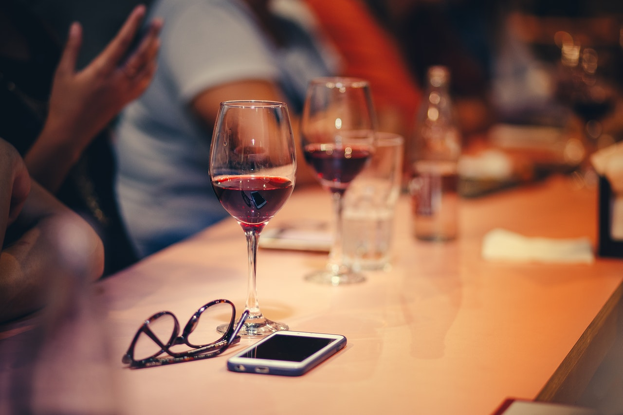 glasses of red wine on the table
